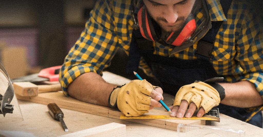 Man marking a piece of wood