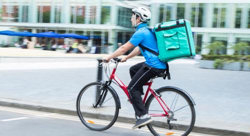 Man with a delivery bag on his bike